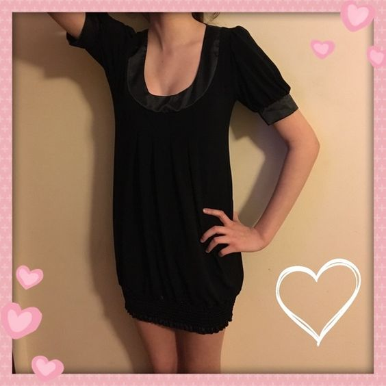 Black party dress Loose in the middle and tight around the legs. Very cute and comfortable. My Michelle Dresses Midi