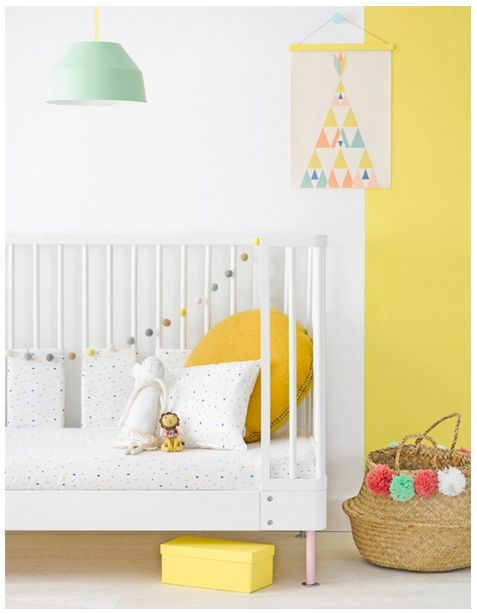 The perfect spring nursery - bright pops of yellow complimented by plain white walls and pops of mint green and other pastel colours. Pretty, simple and sweet.