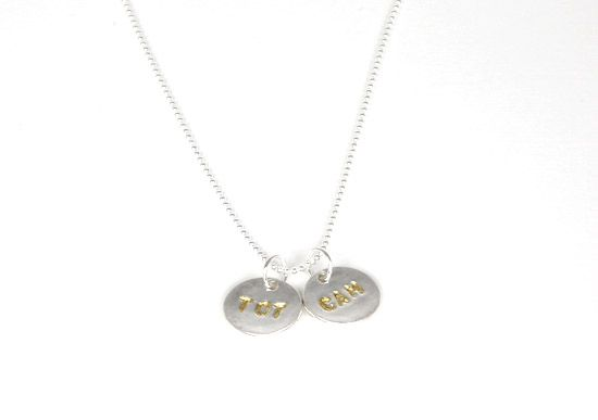 hand stamped necklace.  fine silver stamped with 24k gold.