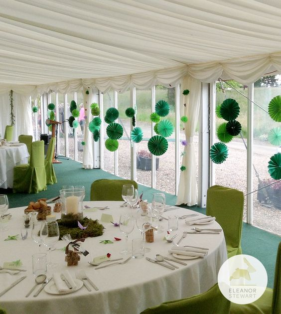 Clusters of green paper rosettes used to decorate a marquee for a birthday party