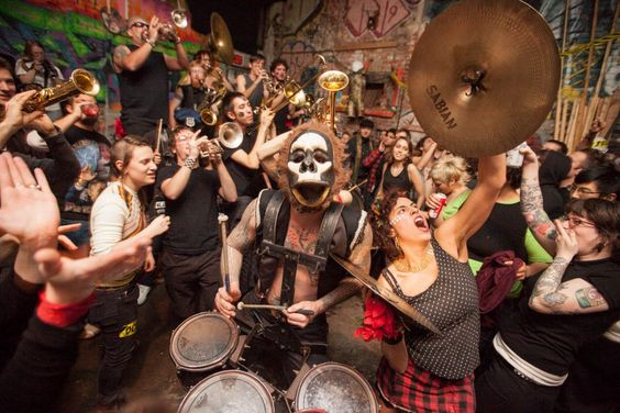 """What Cheer? Brigade, a 19-piece brass band performs in Alphabet City. Seelie has long been involved in the """"vandal-art"""" scene of Brooklyn, w..."""