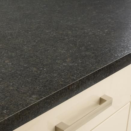 Formica® Laminate Mineral Jet with Radiance finish is a budget friendly update idea for kitchen countertops. Shown with a square profile on white cabinets