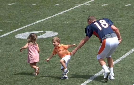 Peyton and his children. Love Marshall's ORANGE shirt!!