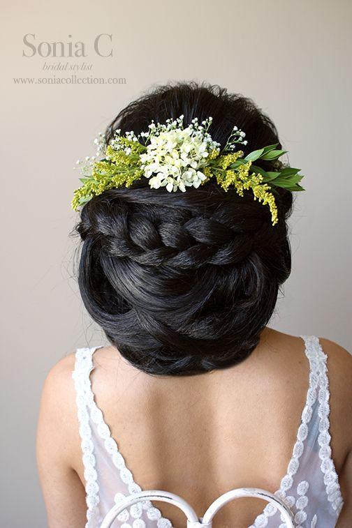 bridal updo low bun braid floral crown big hair boho chic