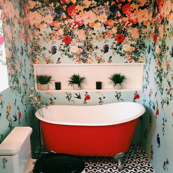 bohemian wallpaper with light base and multi color flowers give lovely look to washroom. the accessory placed according to wall paper pattern add more wow feelings.:
