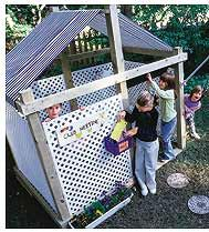 cute backyard playhouse...this would be easy to construct and then we could plant a vine of some sort to climb the lattice