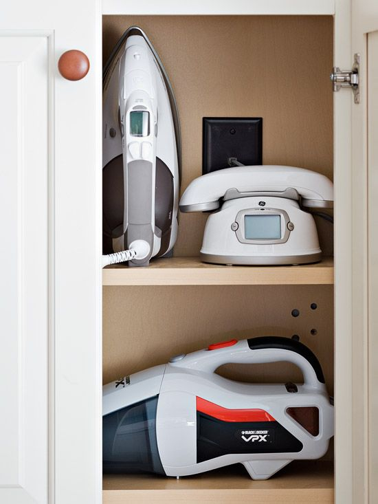 closet with iron and vacuum