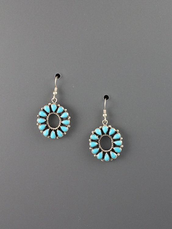 Open center sterling silver cluster earrings set with twelve turquoise cabochons.
