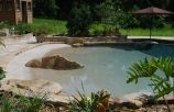 pebble-plaster-beach-entry-rico-rock-boulder-accents-flagstone-coping