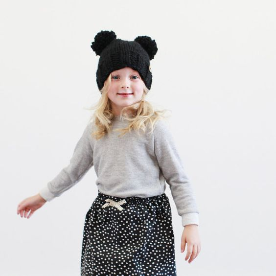 Fun pom pom knit hat! Customize the color with the Etsy shop.
