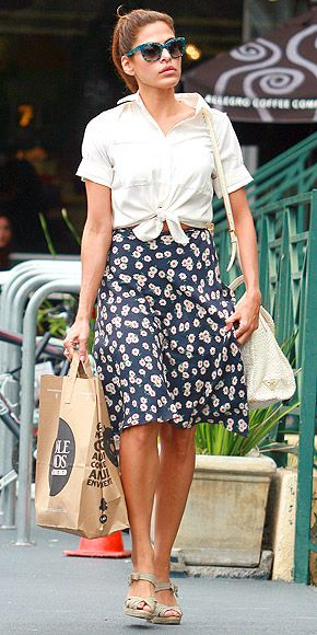 "EVA MENDES'S RETRO SUNNIES  The sunglasses Eva's wearing in 'Stars' Grocery Store Looks' are so fun. Who makes them? – Lauren   Her marbled shades are Thierry Lasry ""Obsessy."" The vintage blue-and-green version she's wearing is currently sold out, but you can still score them in a version flecked with purple on Net-a-Porter for $375."