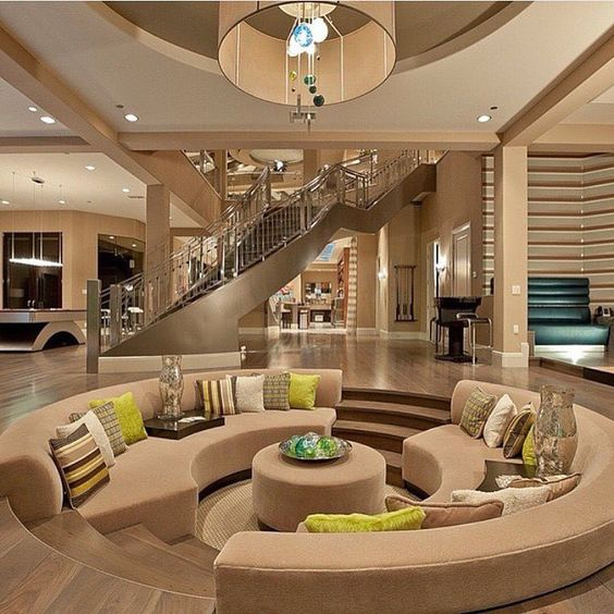 Beautiful modern mansion interior: beige, tan, brown and green color  scheme. SunKen living room couch into floor Stunning Home Interior | Photo