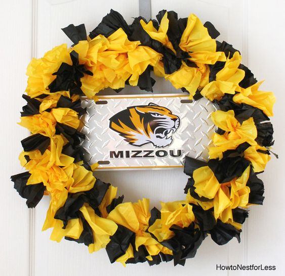Show your school spirit by making this wreath out of a plastic tablecloth. | 18 DIY Dollar-Store Projects That'll Transform Your Dorm For Cheap