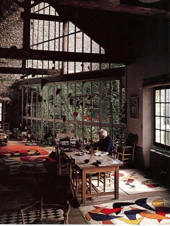 Alexander Calder in his studio. I want those rugs!