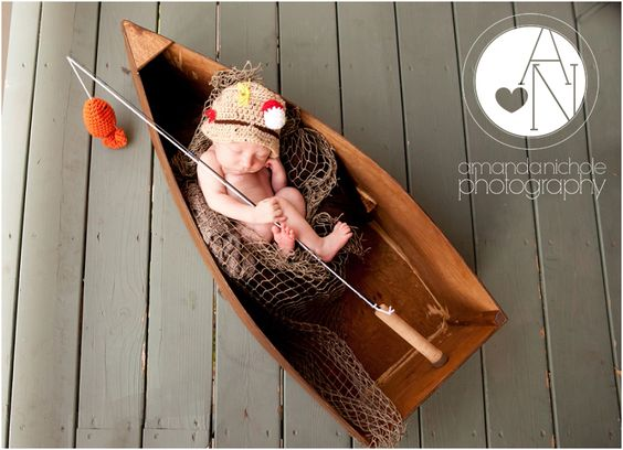 Newborn baby boy posed with fishing gear sports newborn for Baby fishing outfit