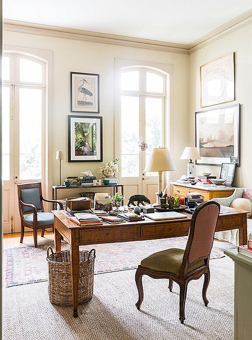 Columnsanda pair of sea-grass mats divide Julia's office area from her sitting area. She's layered the natural-fiber rugs with antique Oriental rugs and an unusual striped dhurrie.