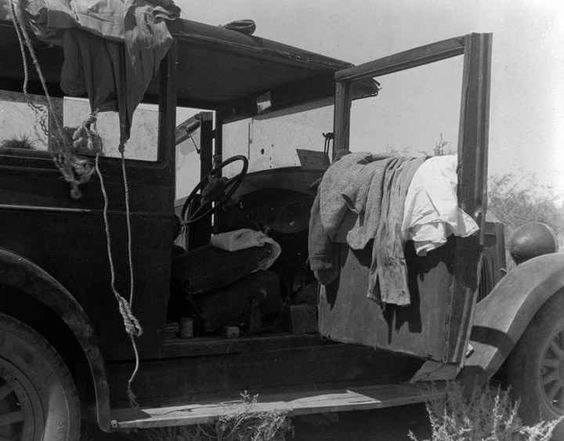 Migrant workers typically resorted to living out of vehicles or in tented camps.  A family of nine lived out this vehicle.