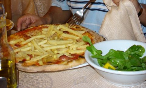 Hot Dog and French Fry Pizza. In Italy they call it the Americana.