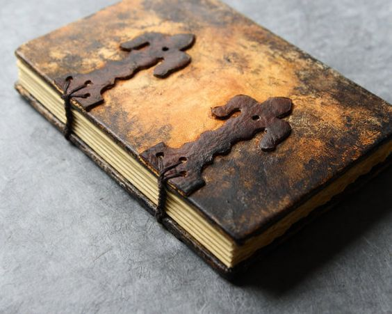 This book was an experiment with antiquing leather. To see more antiqued books, view the steampunk section of this shop.
