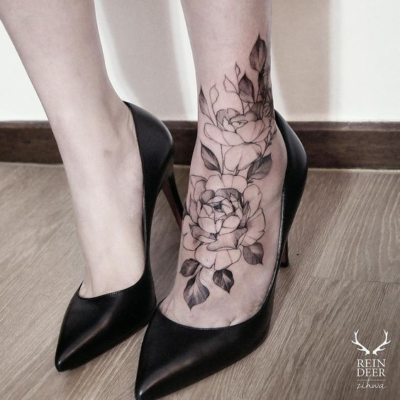 Black Outline Style Nice Looking Ankle Tattoo Of Big Roses With Leaves Ankle Tattoo Tattoos Foot Tattoos For Women
