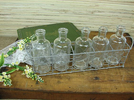 A wonderful way to display a fresh blossom. This metal tray has 5 charming bottles. A perfect vintage look for your kitchen or tabletop. 6 inches x 12 3/4 inches.: Decor Ideas, Decorating Ideas, Basket Bottles, Glass Bottles, Bottles Vases, Wire Baskets, Bedroom Ideas