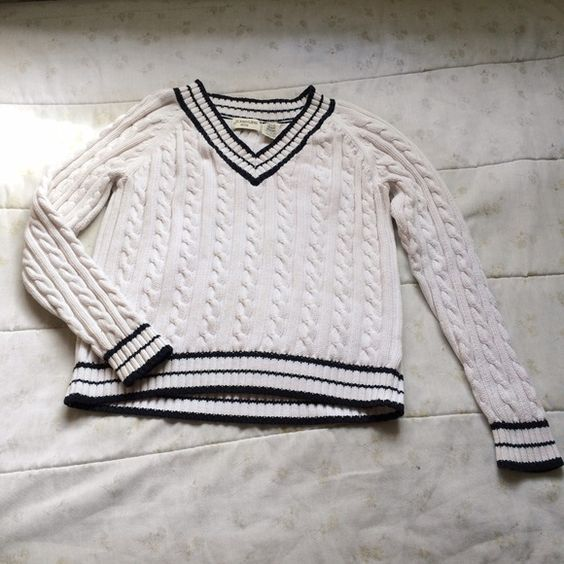 Striped sweater This item is a black and white sweater. On the back right hand side of the sweater is a small yellow stain.  Have any questions? Want to see the item on? Just ask!                                                       Will do bundle discounts St. John's Bay Sweaters V-Necks