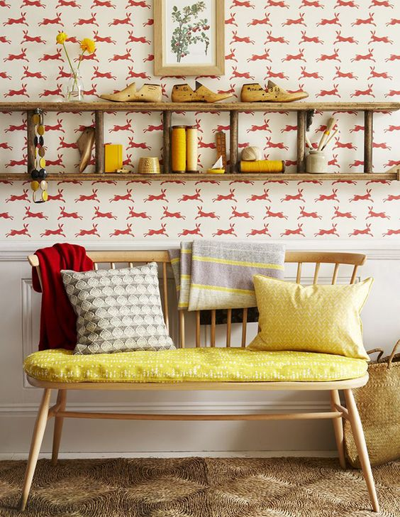 harvest interiors Hallway with hare print wallpaper, ladder shoe rack and bare wood bench