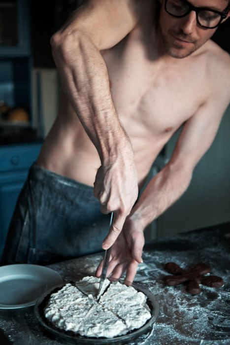 Hot guy in glasses, cooking in nothing but his apron. HELLO FANTASY, YOU CALLED?