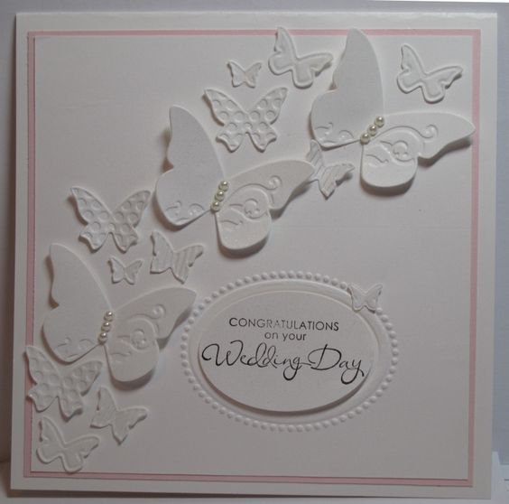 Butterfly embosslit wedding card - lovely card with just a smidge of the pink in the back layer. Gorgeous.    It's all white!  Isn't it beautiful!