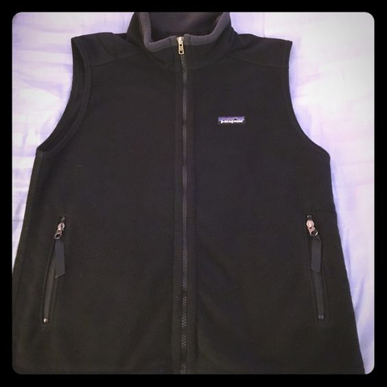 Patagonia black fleece vest! In great condition. Tag says kids XL but fits a women's S. Zip front and front pockets. Reflective stripe in back. Patagonia Jackets & Coats Vests