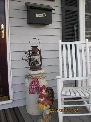 Spring porch.  The ribbon around the old milk can is a great idea. by Sherri32