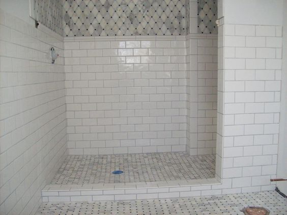 Marble tile shower floor with ceramic subway tile on the walls ...