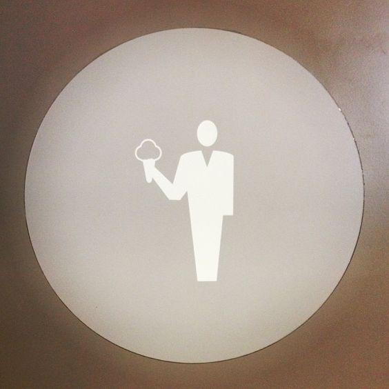 Gelato University bathroom door sign via @Norbert Figueroa ....got to love a funny sign!