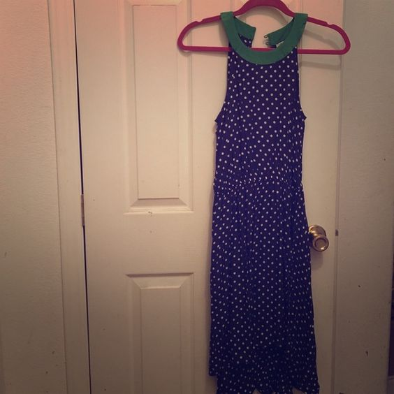 Beautiful anthropologie polka dot dress Navy blue with white dots and green collar. Front is higher than the back at the bottom. Worn once! Perfect condition. No flaws. Anthropologie Dresses