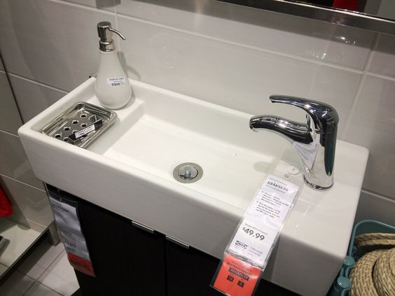 For the bathroom that is partially under the stairs. A small sink for a small…
