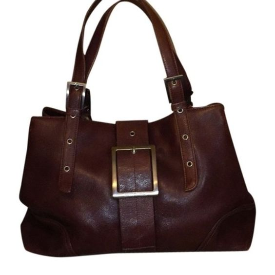 SALEKenneth Cole Handbag Genuine leather Kenneth Cole. Slight discoloration's on outer corners. Very clean, inside no stains. Kenneth Cole Bags