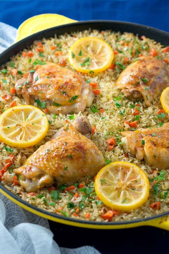 One Skillet Mediterranean Chicken and Rice is an easy and delicious meal the whole family will love. Garlic-seasoned chicken thighs on a bed of rice mixed with colorful veggies.