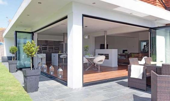 House extension with Sun Canopy. CLICK http://www.hollandgreen.co.uk/house_extensions#.U_L9sPldU7k to see if you could do something similar.