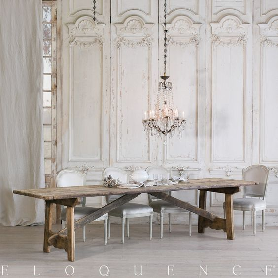French Country dining room with rustic antique pine dining table (1800) from Eloquence, ornate paneled walls, crystal chandelier and elegant European country style. #FrenchCountry #farmtable #farmhousetable