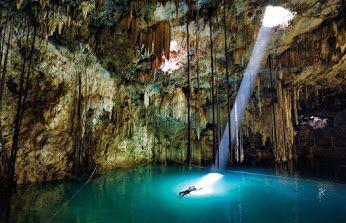 Maya`s natural well inside cave, Guatemala