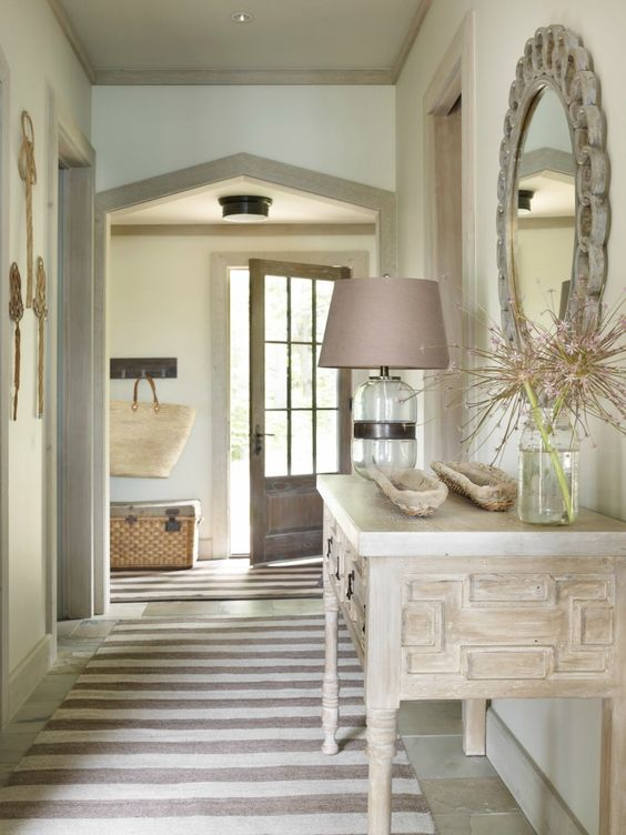 I like the round mirror, and the mauve lamp shade