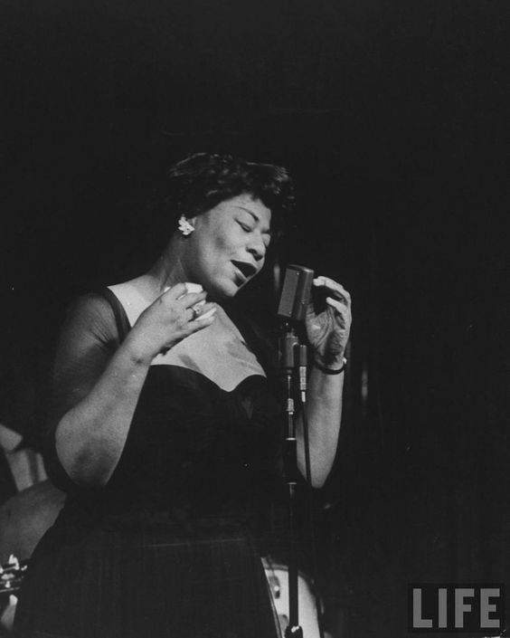 "Ella Fitzgerald (1917 – 1996), known as the ""First Lady of Song"", ""Queen of Jazz"", and ""Lady Ella"", was an American jazz and song vocalist. With a vocal range spanning 3 octaves, she was noted for her purity of tone, impeccable diction, phrasing & intonation, & a ""horn-like"" improvisational ability, particularly in her scat singing. Fitzgerald was a notable interpreter of the Great American Songbook. Over the course of her 59-year recording career, she was the winner of 13 Grammy Awards."