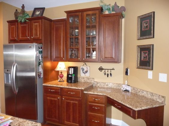 French country kitchen with loads of color cherry wood for Cherry kitchen cabinets wall color