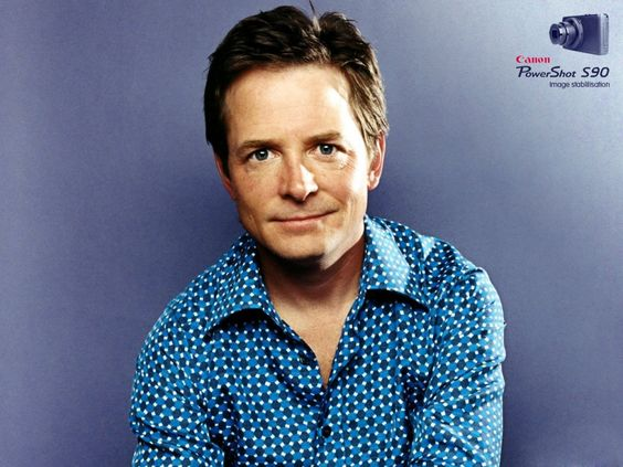 """Famous Canadians-Michael J. Fox was born Michael Andrew Fox on June 9, 1961 in Edmonton, Alberta, Canada. His parents moved their ten-year-old son, his three sisters and brother to Vancouver, British Columbia, after his father, a sergeant in the Canadian Army retired. At age 18, he moved to Los Angelas. Eventually he got the part of Alex P. Keaton on """"Family Ties"""" (1982). He starred in Teen Wolf (1985), High School U.S.A. (1983) (TV), Poison Ivy (1985) (TV) and Back to the Future (1985)."""