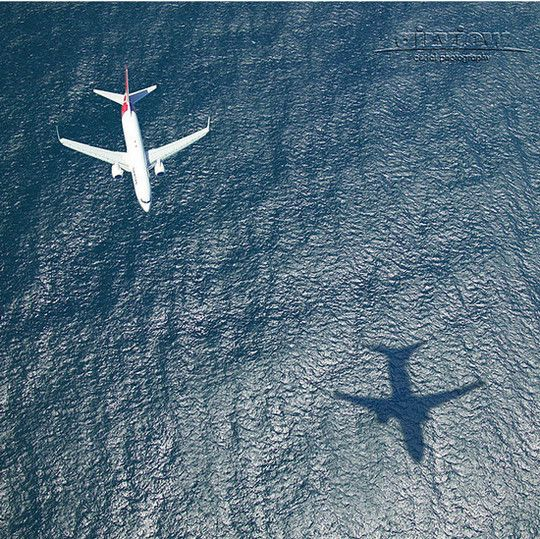 This image has a lot of texture as the water is moving and creates different colours of blue. Specular reflection is present as the plane is flying over the sea and the sun is shining which creates a shadow.