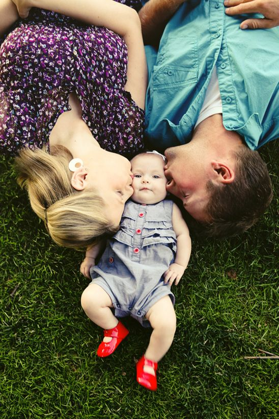 Baby/family photo session-love this pose! By Ampersand Studios via On To Baby {I love the motion you can see in her feet... I can just see those little legs kicking in glee!}