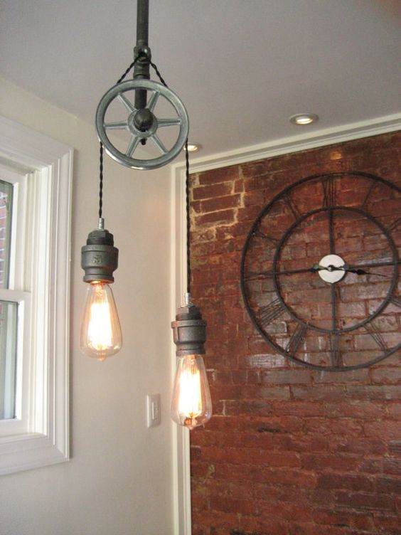 This overhead steel pulley lamp.   18 Steampunk Decor Flourishes That Will Make Any Room Badass