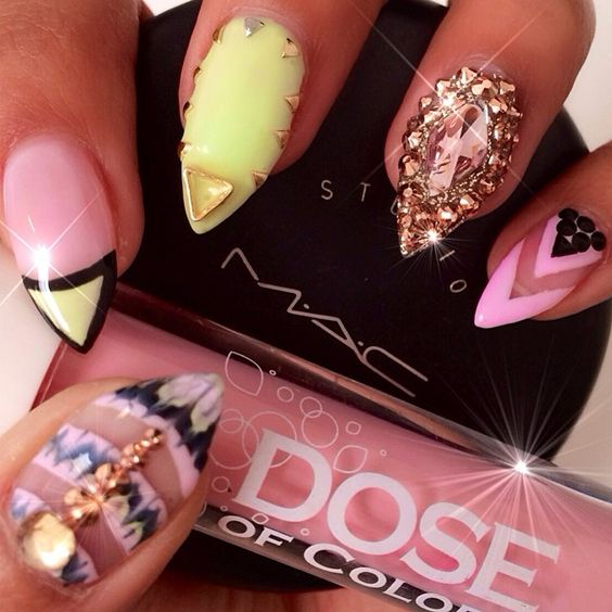@blossombeautylounge  does it again! I can't even handle how creative they are! Thank you @nailsbytintin  for my amazing nails!  Pictured along with my on the go products today @doseofcolors lipgloss and MAC studio fix:) #blossombeautylounge #desimakeup #nailart #nails #doseofcolors #Padgram