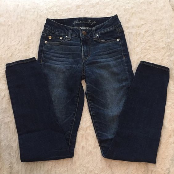 """AE Super Skinny Jeans AE Super Skinny Jeans. Dark wash with faded whisker detail. Excellent condition. Worn once or twice. Size 0 Short. Inseam approx 26.5"""". Would make great ankle/cropped jeans as well. No rips or tears. Super soft and comfortable with great stretch! Reasonable offers considered. American Eagle Outfitters Jeans Skinny"""