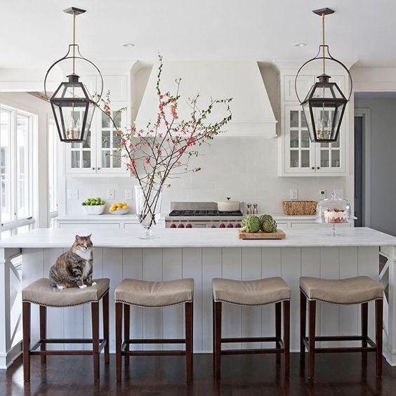 Modern farmhouse kitchen with lanterns, marble, and a kitty on a barstool! Rachel Halvorson Inspired Decorating Tips. #modernfarmhouse #kitchen #lantern